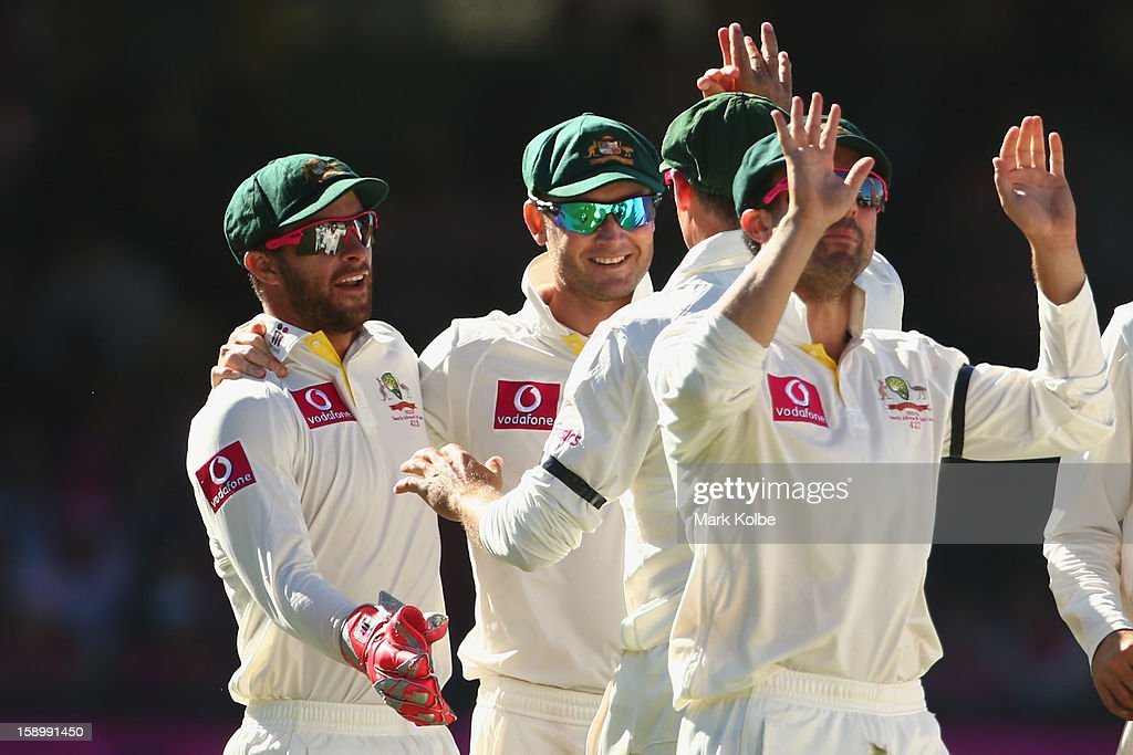 Matthew Wade and Michael Clarke of Australia celebrate after Peter Siddle of Australia took the wicket of Mahela Jayawardene of Sri Lanka during day three of the Third Test match between Australia and Sri Lanka at Sydney Cricket Ground on January 5, 2013 in Sydney, Australia.