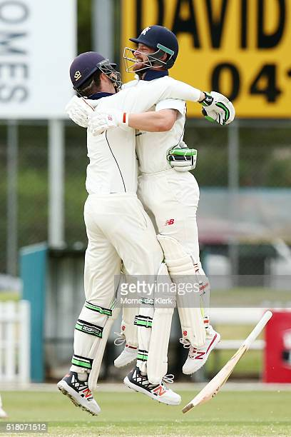 Matthew Wade and Peter Handscomb of the VIC Bushrangers celebrate after hitting the winning runs during day 5 of the Sheffield Shield Final match...