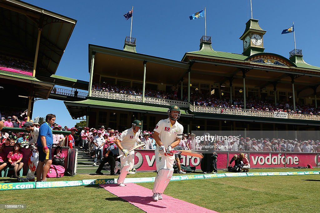 Matthew Wade and Peter Siddle of Australia run out to bat on a pink carpet for Jane McGrath Pink Day during day three of the Third Test match between Australia and Sri Lanka at Sydney Cricket Ground on January 5, 2013 in Sydney, Australia.