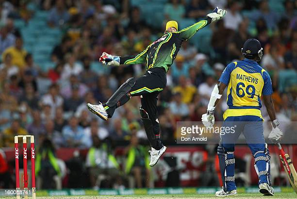 Matthew Wade catches a return from the outfield during game one of the Twenty20 international match between Australia and Sri Lanka at ANZ Stadium on...