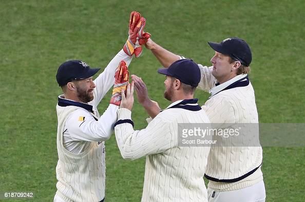 Matthew Wade Daniel Christian and Cameron White of Victoria celebrate as they win the Sheffield Shield match between Victoria and Tasmania at the...
