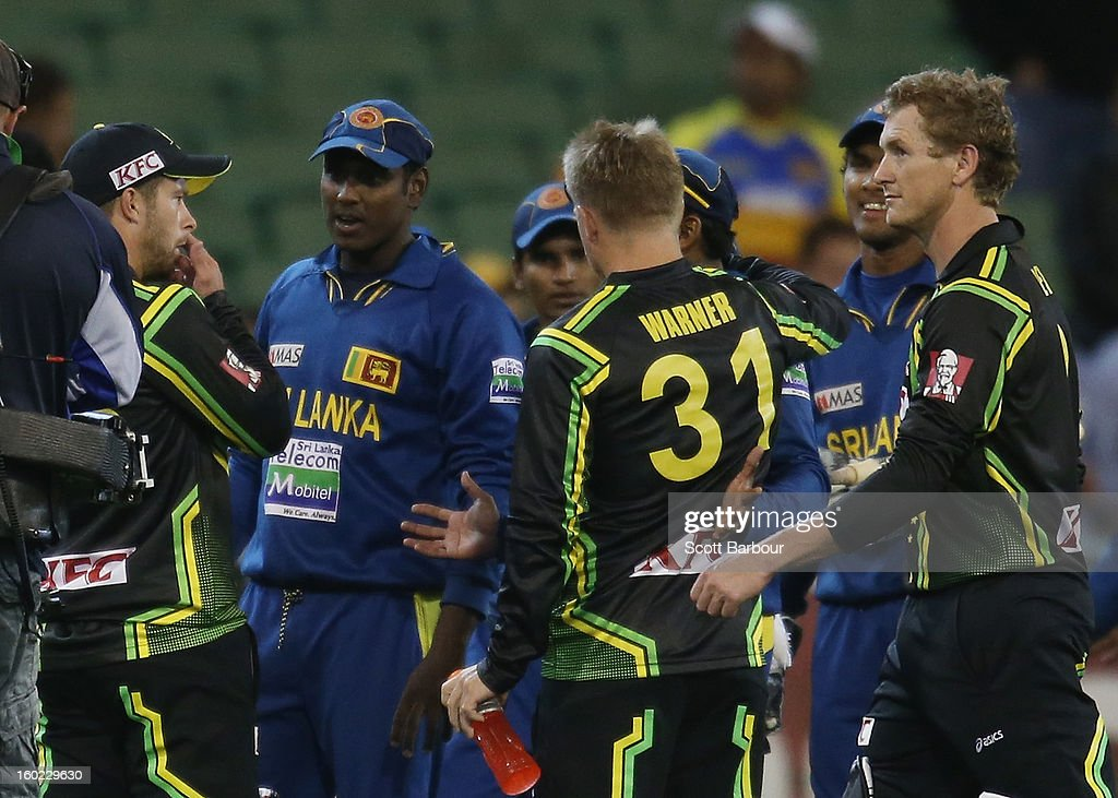Matthew Wade, David Warner and George Bailey of Australia speak with the Sri Lankans as they leave the field after losing during game two of the Twenty20 International series between Australia and Sri Lanka at the Melbourne Cricket Ground on January 28, 2013 in Melbourne, Australia.