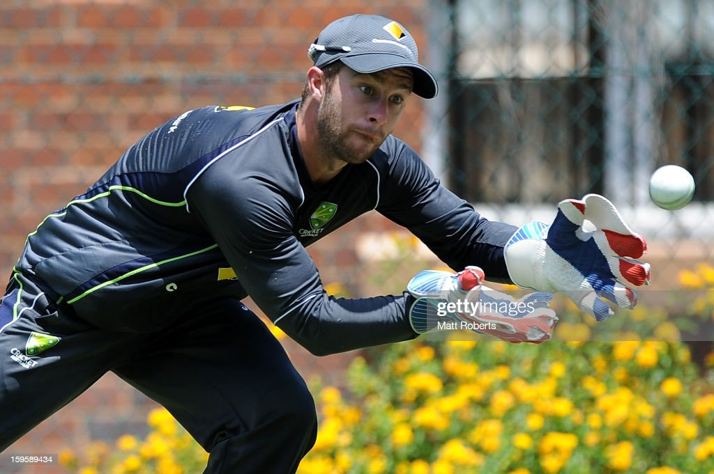 <a gi-track='captionPersonalityLinkClicked' href=/galleries/search?phrase=Matthew+Wade&family=editorial&specificpeople=724041 ng-click='$event.stopPropagation()'>Matthew Wade</a> fields during an Australian training session at The Gabba on January 17, 2013 in Brisbane, Australia.