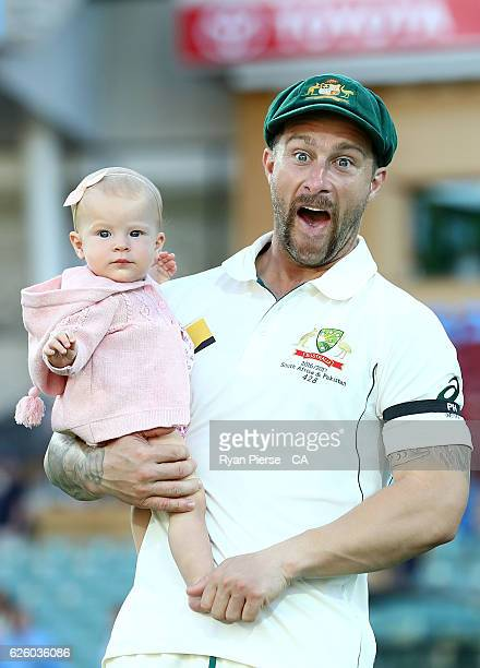 Matthew Wade of Australia and his daughter Winter Wade walk on the ground after day four of the Third Test match between Australia and South Africa...