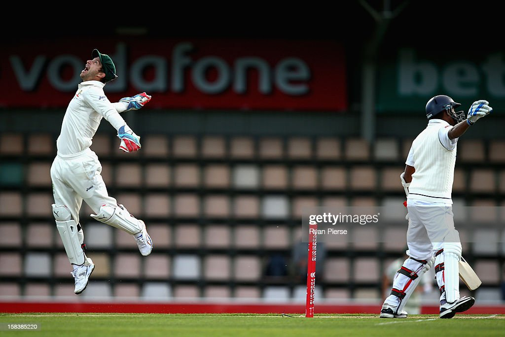 Matthew Wade of Australia celebrates after catching Thilan Samaraweera of Sri Lanka off the bowling of Nathan Lyon of Australia during day two of the First Test match between Australia and Sri Lanka at Blundstone Arena on December 15, 2012 in Hobart, Australia.