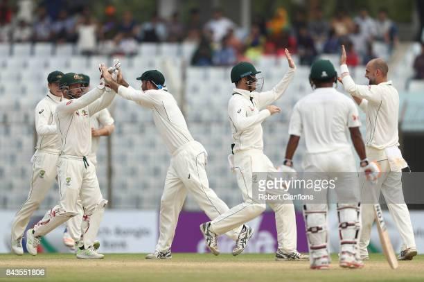 Matthew Wade of Australia celebrates the stumping of Tamim Iqbal Khan of Bangladesh off the bowling of Nathan Lyon of Australia during day four of...