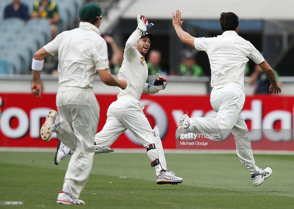 Matthew Wade (C) of Australia celebrates with Mitchell Johnson the dismissal of Tillakaratne Dilshan of Sri Lanka who was caught by Ed Cowan during day three of the Second Test match between Australia and Sri Lanka at Melbourne Cricket Ground on December 28, 2012 in Melbourne, Australia.