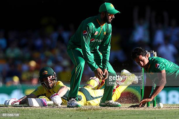 Matthew Wade of Australia dives to the crease during game one of the One Day International series between Australia and Pakistan at The Gabba on...