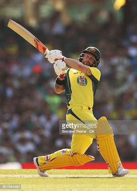 Matthew Wade of Australia hits for six during game one of the One Day International series between Australia and New Zealand at Sydney Cricket Ground...