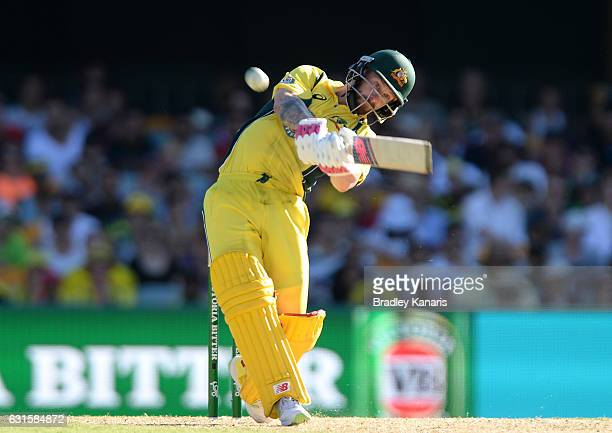 Matthew Wade of Australia hits the ball over the boundary for a six during game one of the One Day International series between Australia and...