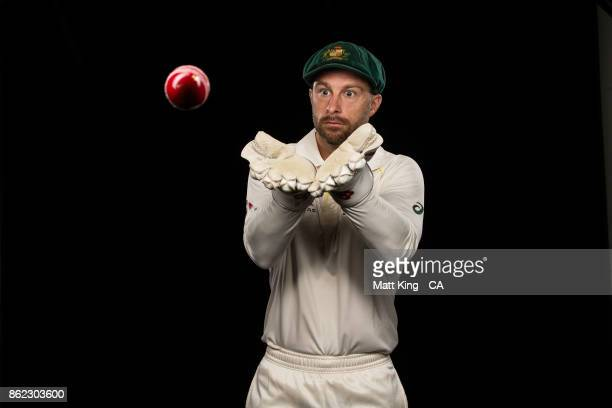 Matthew Wade of Australia poses catching a red ball during the Australia Test cricket team portrait session at Intercontinental Double Bay on October...