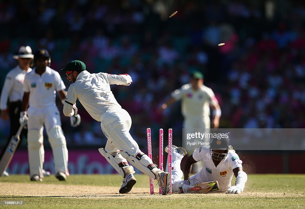 Matthew Wade of Australia runs out Angelo Mathews of Sri Lanka during day three of the Third Test match between Australia and Sri Lanka at Sydney Cricket Ground on January 5, 2013 in Sydney, Australia.