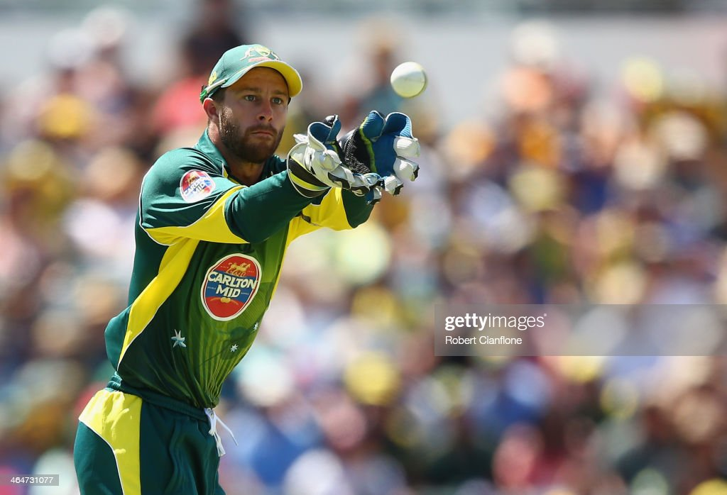 <a gi-track='captionPersonalityLinkClicked' href=/galleries/search?phrase=Matthew+Wade&family=editorial&specificpeople=724041 ng-click='$event.stopPropagation()'>Matthew Wade</a> of Australia takes the ball during game four of the One Day International series between Australia and England at WACA on January 24, 2014 in Perth, Australia.