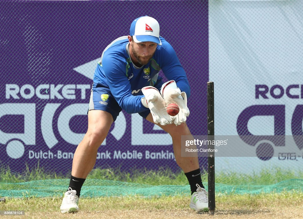 Matthew Wade of Australia wicketkeeps during an Australian Test team nets session at Sher-E Bangla National Cricket Stadium on August 22, 2017 in Dhaka, Bangladesh.