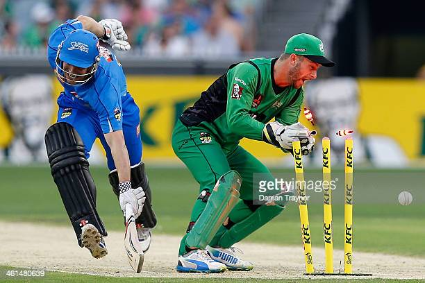 Matthew Wade of the Stars attempts to run out Michael Nesser of the Strikers during the Big Bash League match between the Melbourne Stars and the...