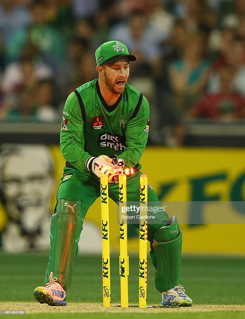 <a gi-track='captionPersonalityLinkClicked' href=/galleries/search?phrase=Matthew+Wade&family=editorial&specificpeople=724041 ng-click='$event.stopPropagation()'>Matthew Wade</a> of the Stars breaks the stumps during the Big Bash League match between the Melbourne Stars and the Adelaide Strikers at the Melbourne Cricket Ground on January 9, 2014 in Melbourne, Australia.
