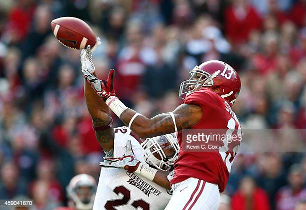 Matthew Wells of the Mississippi State Bulldogs breaks up this reception intended for ArDarius Stewart of the Alabama Crimson Tide at BryantDenny...