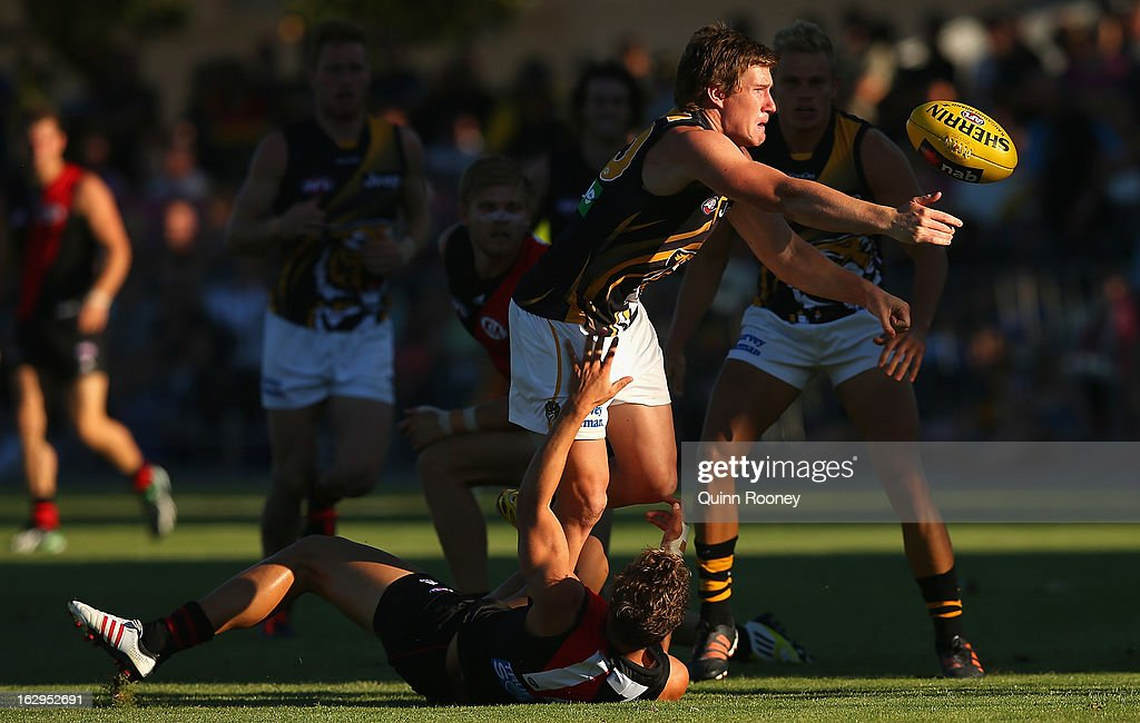 Matthew White of the Tigers handballs during the round two AFL NAB Cup match between the Essendon Bombers and the Richmond Tigers at Wangaratta Showgrounds on March 2, 2013 in Wangaratta, Australia.
