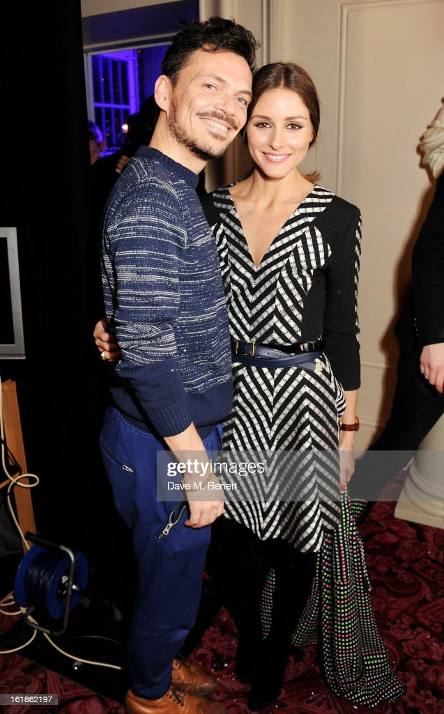 Matthew Williamson (L) and <a gi-track='captionPersonalityLinkClicked' href=/galleries/search?phrase=Olivia+Palermo&family=editorial&specificpeople=2639086 ng-click='$event.stopPropagation()'>Olivia Palermo</a> pose backstage at the Matthew Williamson show during London Fashion Week Fall/Winter 2013/14 at the Royal Opera House on February 17, 2013 in London, England.