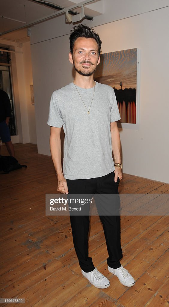 Matthew Williamson attends the VIP launch of the 'Hand To Earth' exhibition hosted by Matthew Williamson at Scream Gallery on September 5, 2013 in London, England.