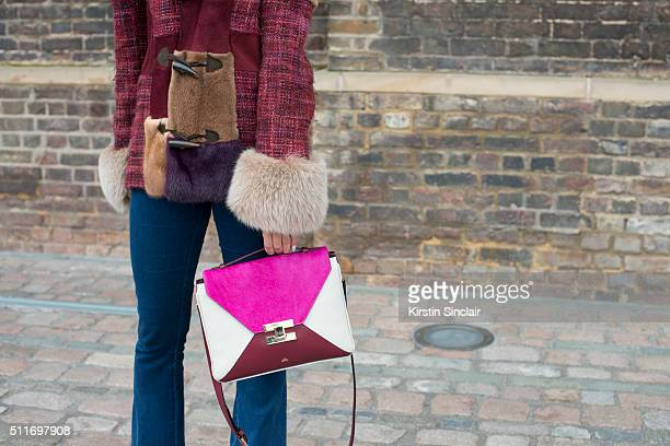 Matthew Williamson PR executive Gabriela Fones wears a vintage Matthew Williamson jacket H and M jeans and Milli Millu bag on day 3 during London...