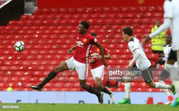 Matthew Willock of Manchester United U23s in action with Luke Amos of Tottenham Hotspur U23s during the Premier League 2 match between Manchester...