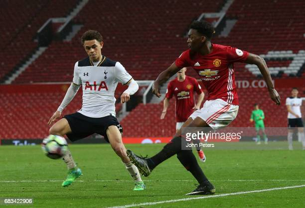 Matthew Willock of Manchester United U23s in action with Luke Amos of Tottenham Hotspur during the Premier League 2 match between Manchester United...