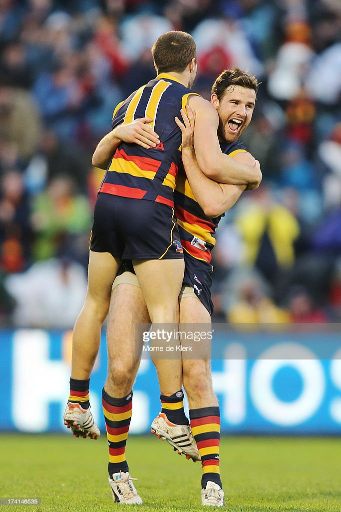 Matthew Wright and Andy Otten of the Crows celebrate after Wright kicked a late goal during the round 17 AFL match between the Adelaide Crows and the Geelong Cats at AAMI Stadium on July 21, 2013 in Adelaide, Australia.