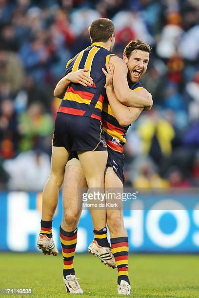 Matthew Wright and Andy Otten of the Crows celebrate after Wright kicked a late goal during the round 17 AFL match between the Adelaide Crows and the...