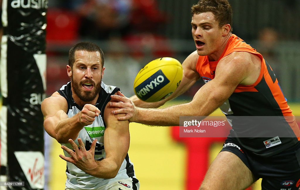 Matthew Wright of Carlton hand balls during the round 14 AFL match between the Greater Western Sydney Giants and the Carlton Blues at Spotless Stadium on June 25, 2016 in Sydney, Australia.