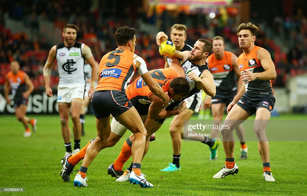 Matthew Wright of Carlton is tackled during the round 14 AFL match between the Greater Western Sydney Giants and the Carlton Blues at Spotless Stadium on June 25, 2016 in Sydney, Australia.