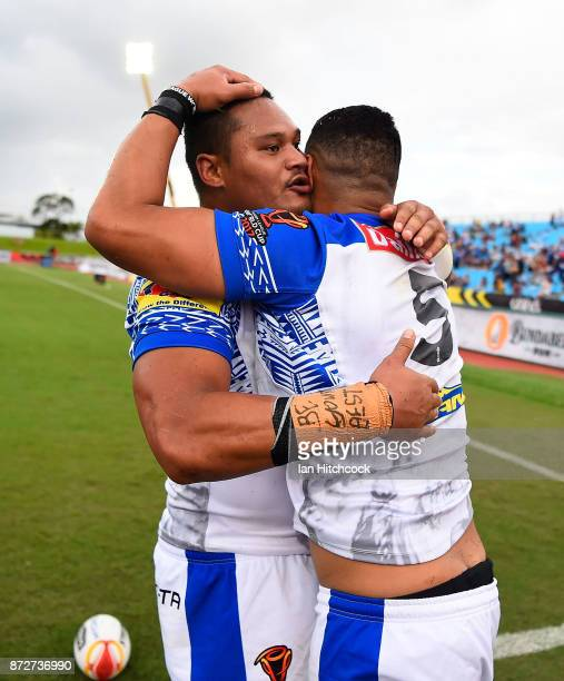 Matthew Wright of Samoa celebrates after scoring a try with Joseph Leilua during the 2017 Rugby League World Cup match between Samoa and Scotland at...