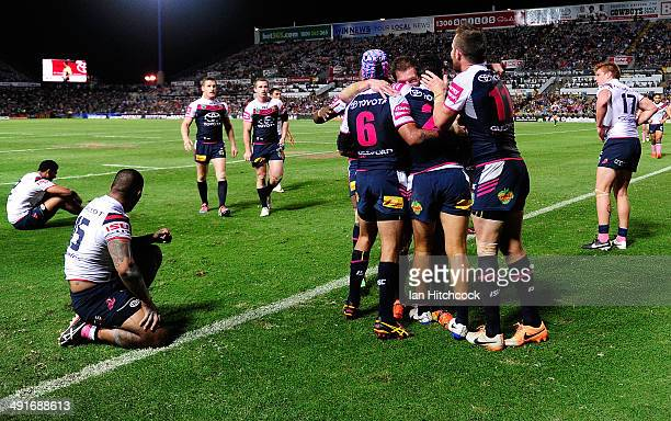 Matthew Wright of the Cowboys celebrates with team mates after scoring a try during the round 10 NRL match between the North Queensland Cowboys and...