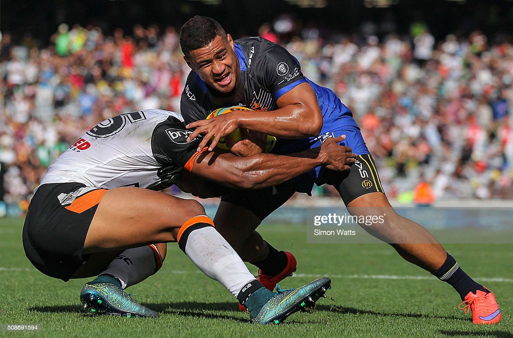 Matthew Wright of the Cowboys is tackled during the 2016 Auckland Nines match between the Cowboys and the Tigers at Eden Park on February 6, 2016 in Auckland, New Zealand.