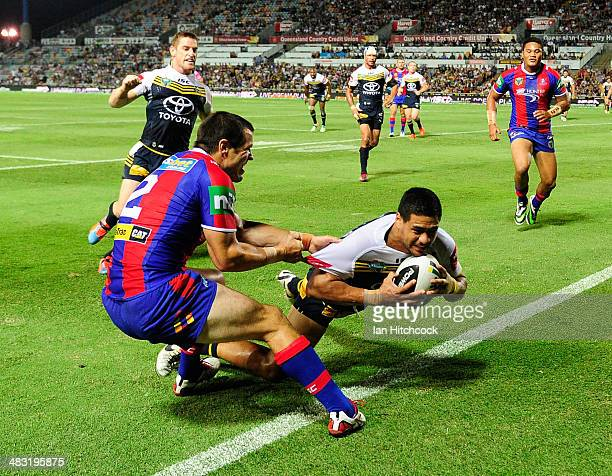 Matthew Wright of the Cowboys scores a try during the round five NRL match between the North Queensland Cowboys and the Newcastle Knights at...