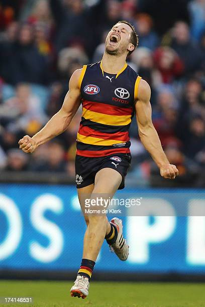 Matthew Wright of the Crows celebrates after kicking a late goal during the round 17 AFL match between the Adelaide Crows and the Geelong Cats at...