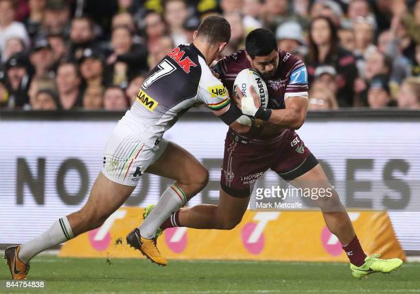 Matthew Wright of the Sea Eagles is tackled by Nathan Cleary of the Panthers during the NRL Elimination Final match between the Manly Sea Eagles and...