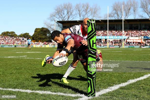 Matthew Wright of the Sea Eagles scores a try during the round 22 NRL match between the Manly Warringah Sea Eagles and the Sydney Roosters at...