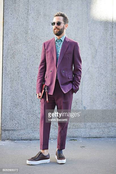 Matthew Zorpas poses in a Salvatore Ferragamo total look before the Ferragamo show during the Milan Men's Fashion Week Fall/Winter 2016/17 on January...