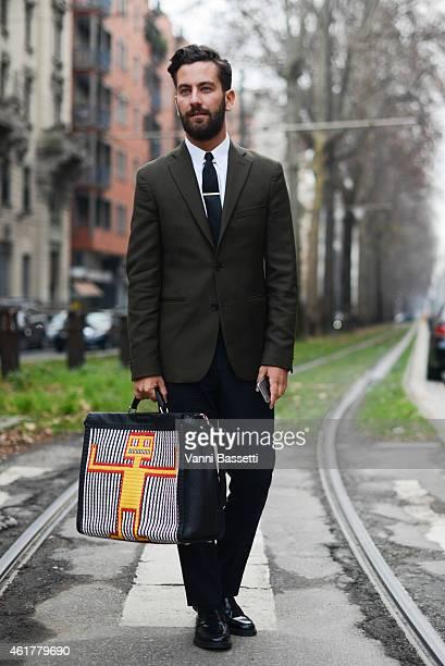Matthew Zorpas poses wearing an Acne suit and Fendi bag during day 3 of Milan Menswear Fashion Week Fall/Winter 2015/2016 on January 19 2015 in Milan...