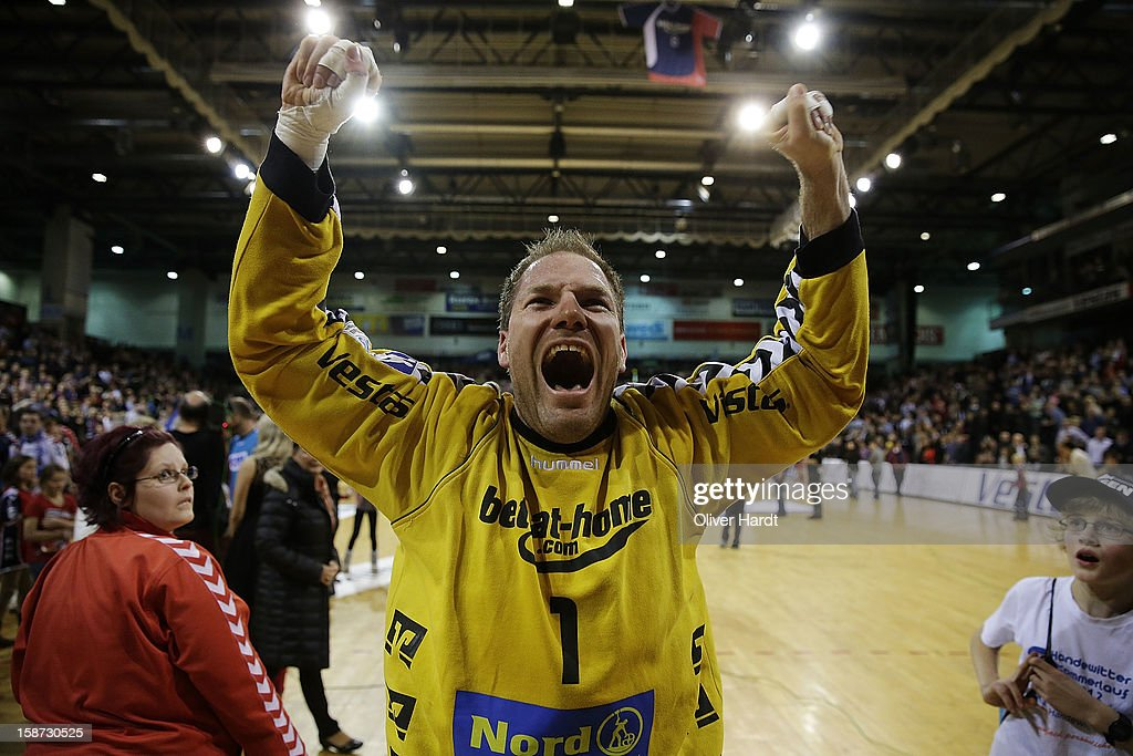 Matthias Andersson of Flensburg celebrate after winning the DKB Handball Bundesliga match between Flensburg-Handewitt and THW Kiel at Campus Hall on December 26, 2012 in Flensburg, Germany.