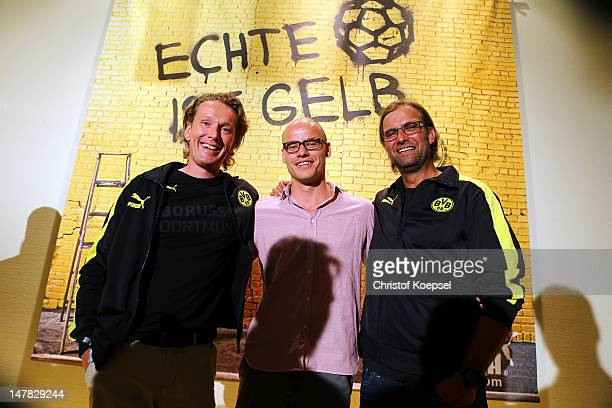 Matthias Baeumer chairman of Puma Germany Franz Koch CEO Puma and head coach Juergen Klopp pose during the Borussia Dortmund Puma kit launch at...