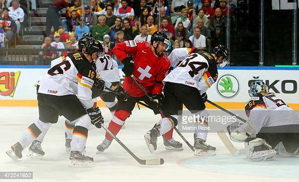 Matthias Bieber of Switzerland and Benedikt Kohl of Germany battle for the puck during the IIHF World Championship group A match between Switzerland...