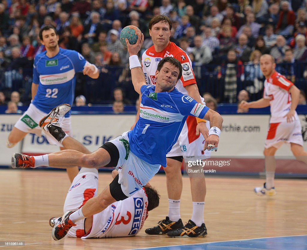 <a gi-track='captionPersonalityLinkClicked' href=/galleries/search?phrase=Matthias+Flohr&family=editorial&specificpeople=626656 ng-click='$event.stopPropagation()'>Matthias Flohr</a> of Hamburg throws a goal during the Bundesliga match between Hamburger SV and SC Magdeburg at the O2 world on February 12, 2013 in Hamburg, Germany.