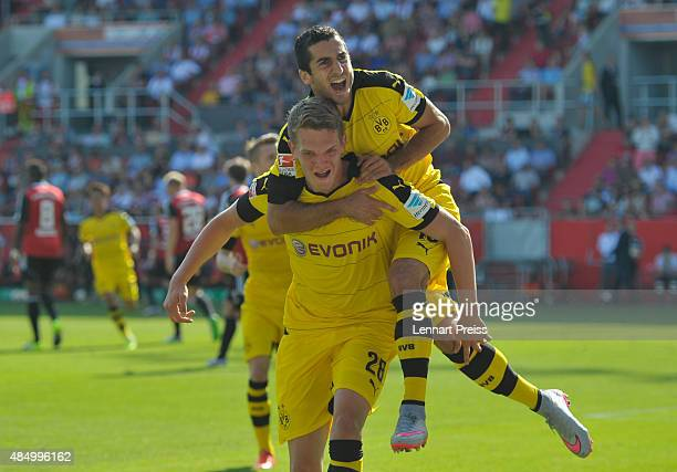 Matthias Ginter and Henrikh Mkhitraryan of Borussia Dortmund celebrate scoring the opening goal during the Bundesliga match between FC Ingolstadt and...