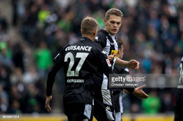 Matthias Ginter and Michael Cuisance of Borussia Moenchengladbach celebrate the first goal during the Bundesliga match between Borussia...