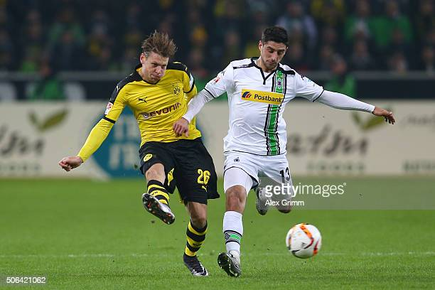Matthias Ginter of Borussia Dortmund beats Lars Stindl of Borussia Moenchengladbach to the ball during the Bundesliga match between Borussia...