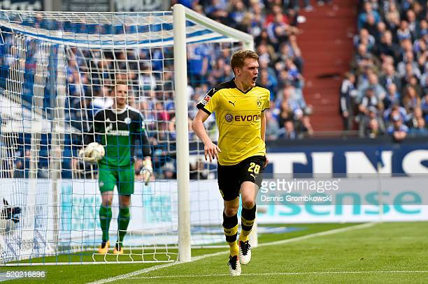 Matthias Ginter of Borussia Dortmund celebrates after scoring his team's second goal during the Bundesliga match between FC Schalke 04 and Borussia...