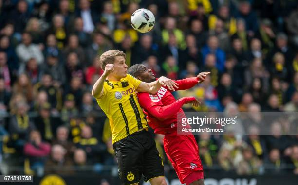 Matthias Ginter of Borussia Dortmund challenges Anthony Modeste of 1 FC Koeln during the Bundesliga match between Borussia Dortmund and FC Koeln at...