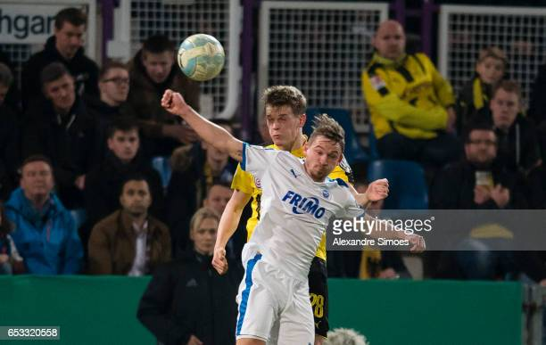 Matthias Ginter of Borussia Dortmund challenges Kevin Freiberger of Lotte during the DFB Cup Quarter Final match between Sportfreunde Lotte and...